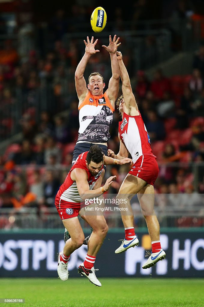 Steve Johnson of the Giants is challenged by Heath Grundy (L) and Dane Rampe (R) of the Swans during the round 12 AFL match between the Greater Western Sydney Giants and the Sydney Swans at Spotless Stadium on June 12, 2016 in Sydney, Australia.