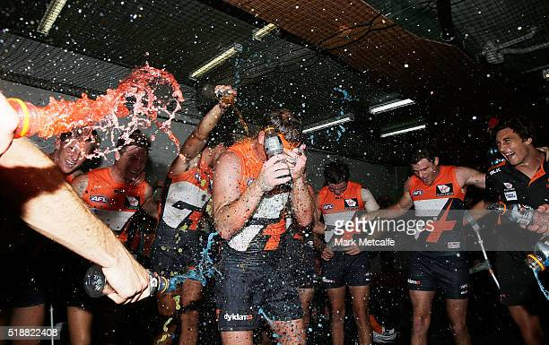 Steve Johnson of the Giants is sprayed with drinks by team mates after victory in the round two AFL match between the Greater Western Sydney Giants...