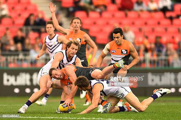 Steve Johnson of the Giants is tackled Hayden Crozier of the Dockers during the roUnd 22 AFL match between the Greater Western Sydney Giants and the...