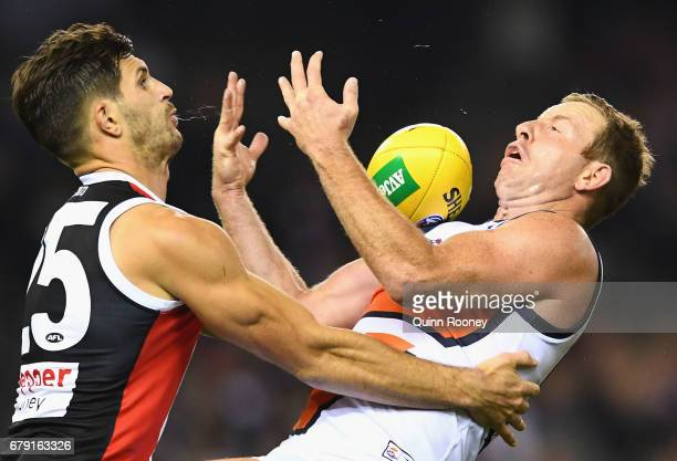 Steve Johnson of the Giants marks infront of Koby Stevens of the Saints during the round seven AFL match between the St Kilda Saints and the Greater...
