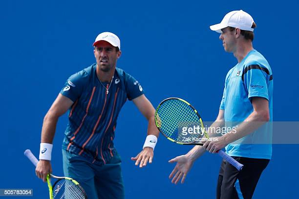 Steve Johnson of the United States and Sam Querrey of the United States talk tactics in their first round match against Lukas Rosol of the Czech...