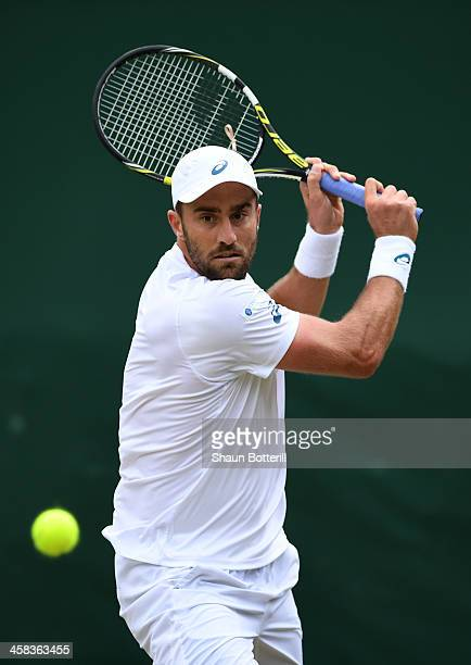 Steve Johnson of The United States plays a backhand during the Men's Singles third round match against Grigor Dimitrov of Bulgaria on day six of the...