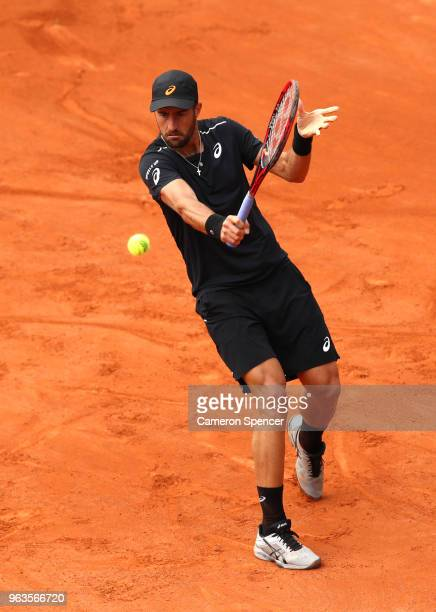 Steve Johnson of The United States plays a backhand during the mens singles first round match against Adrian Mannarino of France during day three of...