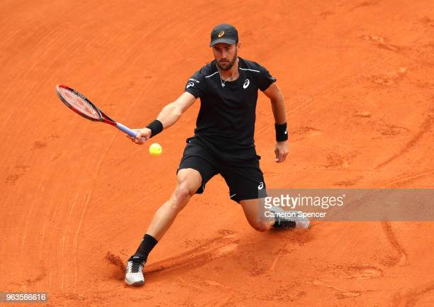 Steve Johnson of The United States plays a forehand during the mens singles first round match against Adrian Mannarino of France during day three of...