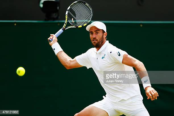 Steve Johnson of the United States plays a forehand in his Gentlemens Singles Second Round match against Grigor Dimitrov of Bulgaria during day three...