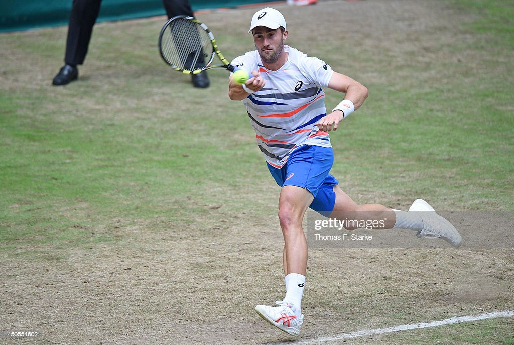Steve Johnson of the United States plays a forehand in his match against Kei Nishikori of Japan during day five of the Gerry Weber Open at Gerry Weber Stadium on June 13, 2014 in Halle, Germany.