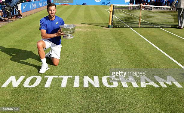 Steve Johnson of the United States poses his trophy after defeating Pablo Cuevas of Uruguay in his men's singles final match during day six of the...
