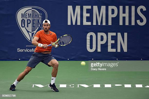 Steve Johnson of the United States returns a shot to Taylor Fritz of the United States during their singles match on Day 4 of the Memphis Open at the...