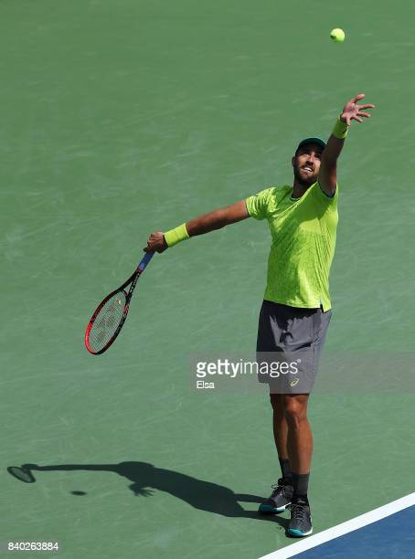 Steve Johnson of the United States serves during his first round Men's Singles match against Nicolas Almagro of Spain on Day One of the 2017 US Open...