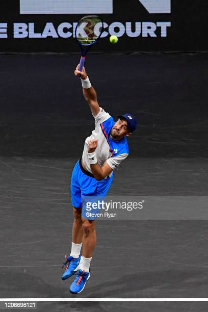 Steve Johnson of the United States serves the ball during his Men's Double's final match against Dominic Inglot of Great Britain and Aisam-Ul-Haq...