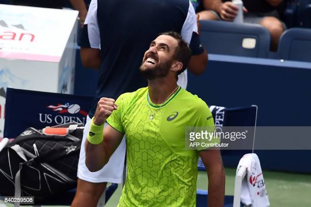 Steve Johnson of the US reacts after defeating Spain's Nicolas Almagro during their 2017 US Open Men's Singles match at the USTA Billie Jean King...