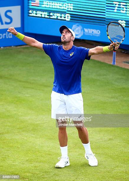 Steve Johnson of The USA celebrates victory in his first round match against Richard Gasquet of France on day one of the Aegon Championships at the...