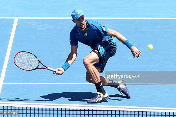 Steve Johnson of the USA plays a return during his mens singles match against John Isner of the USA serves during the ASB Classic on January 12 2017...