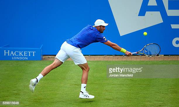 Steve Johnson of The USA reaches for a backhand during his first round match against Richard Gasquet of France on day one of the Aegon Championships...