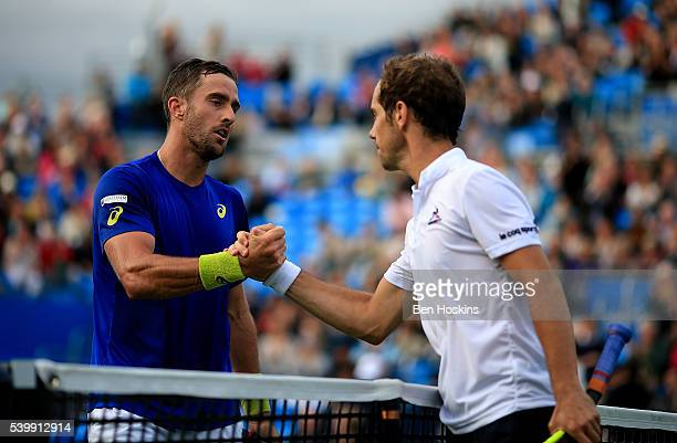 Steve Johnson of The USA shakes the hand of Richard Gasquet of France following their first round match on day one of the Aegon Championships at...