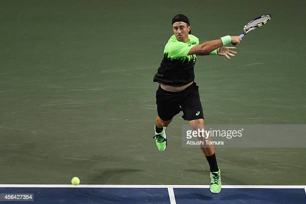 Steve Johnson of USA in action during the men's singles second round match against Marcel Granollers of Spain on day three of Rakuten Open 2014 at...