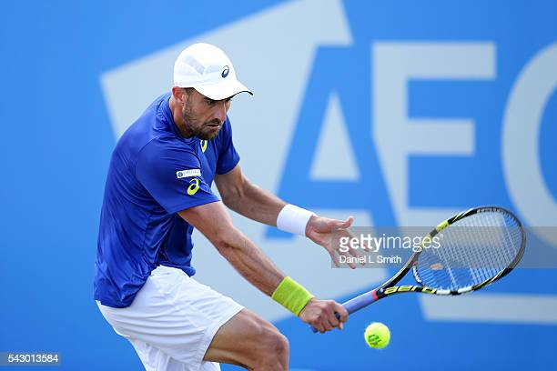 Steve Johnson of USA plays a backhand during his men's singles final match against Pablo Cuevas of Uruguay during day six of the ATP Aegon Open...