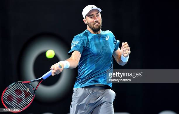 Steve Johnson of USA plays a forehand in his match against Alex De Minaur of Australia during day one at the 2018 Brisbane International at Pat...