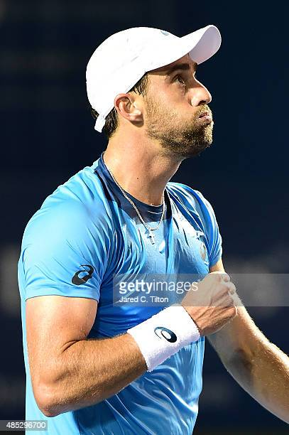Steve Johnson reacts after defeating JoWilfried Tsonga of France during the third day of the WinstonSalem Open at Wake Forest University on August 26...