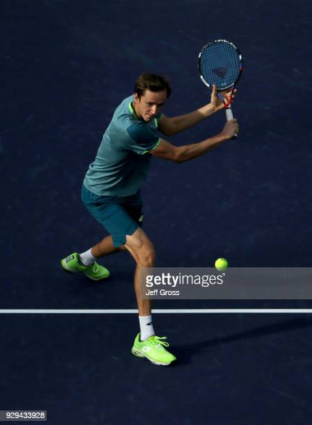 Steve Johnson returns a backhand volley to Daniil Medvedev of Russia during the BNP Paribas Open at the Indian Wells Tennis Garden on March 8 2018 in...