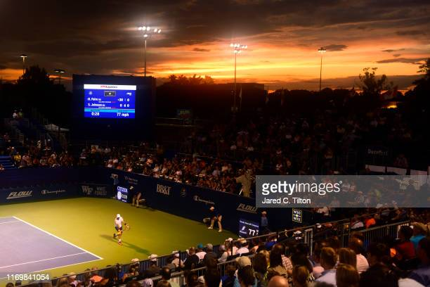 Steve Johnson returns a shot from Benoit Paire of France during their semifinals match on day seven of the Winston-Salem Open at Wake Forest...