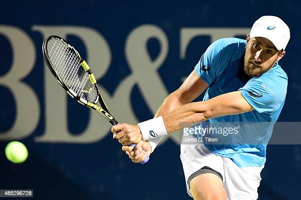 Steve Johnson returns a shot from JoWilfried Tsonga of France during the third day of the WinstonSalem Open at Wake Forest University on August 26...