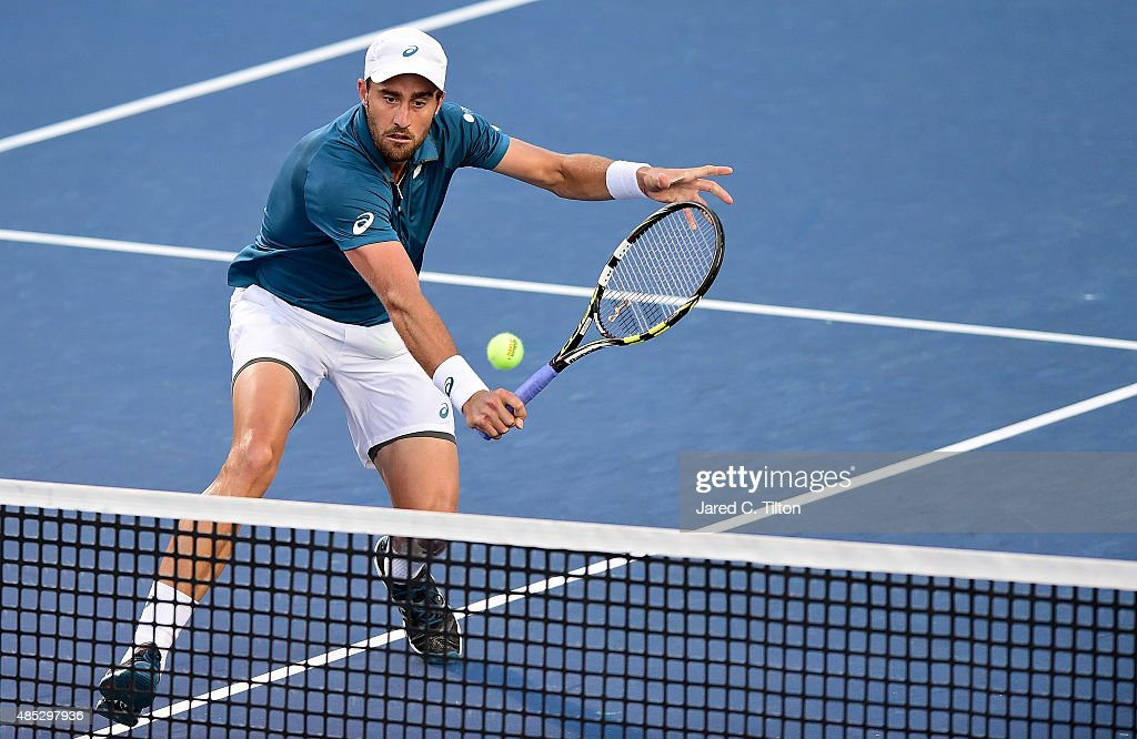 Steve Johnson returns a shot from Jo-Wilfried Tsonga of France during the third day of the Winston-Salem Open at Wake Forest University on August 26, 2015 in Winston-Salem, North Carolina.