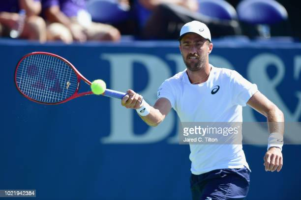Steve Johnson returns a shot from Kyle Edmund of Great Britain during their quarterfinals match on day four of the Winston-Salem Open at Wake Forest...