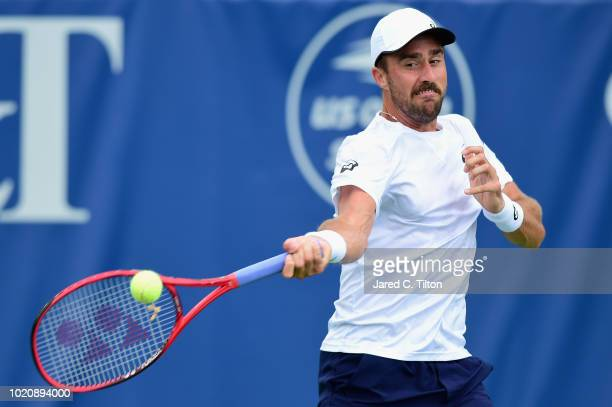Steve Johnson returns a shot from Tommy Paul during their match on day two of the Winston-Salem Open at Wake Forest University on August 21, 2018 in...