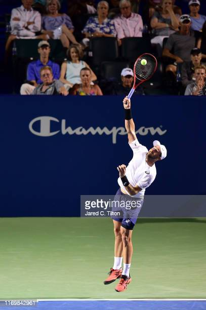 Steve Johnson serves to Benoit Paire of France during their semifinals match on day seven of the Winston-Salem Open at Wake Forest University on...