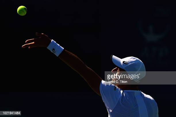 Steve Johnson serves to Kyle Edmund of Great Britain during their quarterfinals match on day four of the Winston-Salem Open at Wake Forest University...
