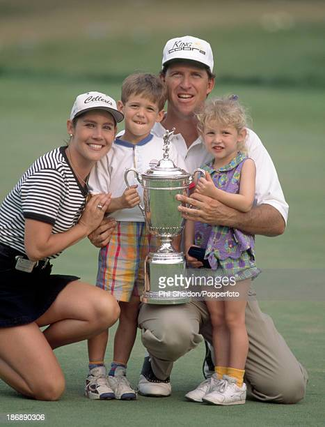 Steve Jones of the United States with his wife Bonnie as he holds the trophy with his son Cy and daughter Stacy after winning the US Open Golf...