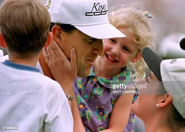 Steve Jones of the US is congratulated by his wife Bonnie and children Cy and Stacey after he won the US Open golf championship 16 June at Oakland...