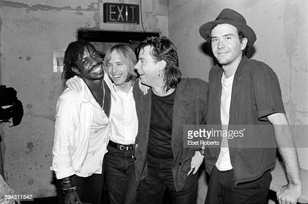 Steve Jordan Tom Petty Michael Shrieve and actor Timothy Hutton backstage at a Tom Petty show at the Jones Beach Theater in Wantagh Long Island NY on...