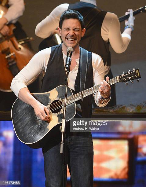 Steve Kazee performs on stage with the case of 'Once the Musical' onstage at the 66th Annual Tony Awards at The Beacon Theatre on June 10 2012 in New...