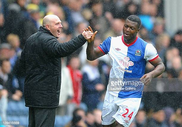 Steve Keane of Blackburn Rovers congratulates Yakubu on scoring the third goal during the Barclays Premier League match between Blackburn Rovers and...