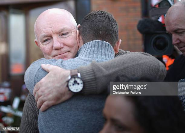 Steve Kelly of the Hillsborough Justice Campaign group embraces a fan as they arrive at Anfield for the memorial service marking the 25th anniversary...