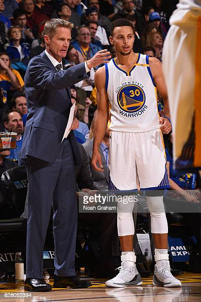 Steve Kerr and Stephen Curry talk during the game against the Indiana Pacers on December 5 2016 at ORACLE Arena in Oakland California NOTE TO USER...