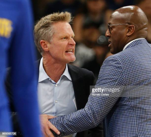 Steve Kerr head coach of Golden State Warriors is restrained by Mike Brown after getting a technical during game against San Antonio Spurs at ATT...