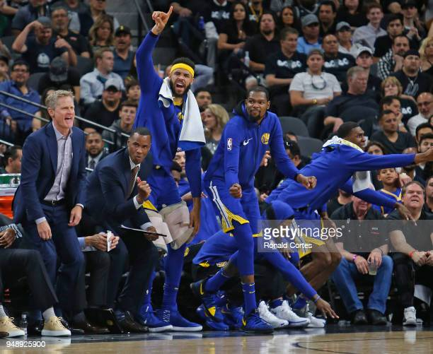 Steve Kerr head coach of the Golden State Warriors and the rest of the warriors celebrate a basket against the San Antonio Spurs at ATT Center on...