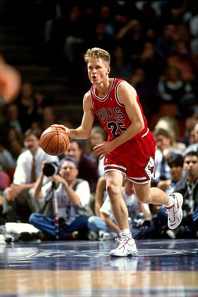dfa1f25ab HOUSTON -1996  Steve Kerr  25 of the Chicago Bulls dribbles upcourt against  the Houston Rockets during an NBA game circa 1996 at the Summit in Houston