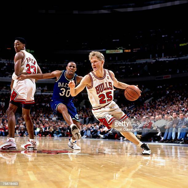 Steve Kerr of the Chicago Bulls drives to the basket against the Dallas Mavericks during a 1996 NBA game at the United Center in Chicago Illinois...
