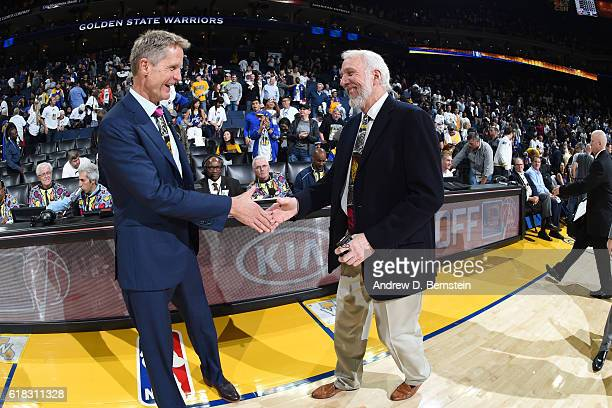 Steve Kerr of the Golden State Warriors and Gregg Popovich of the San Antonio Spurs prior to the game on October 25 2016 at ORACLE Arena in Oakland...
