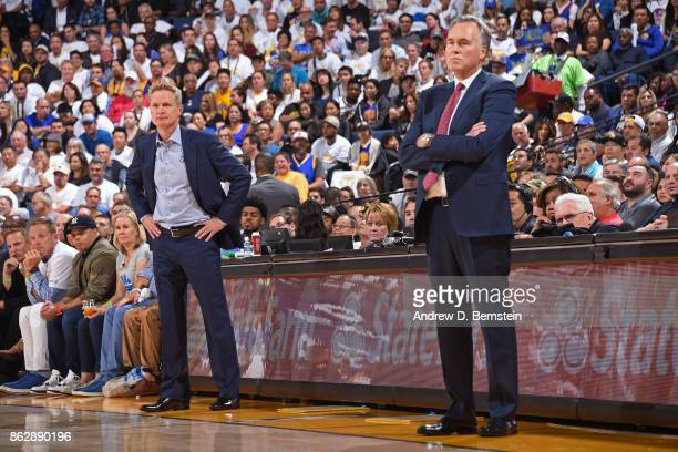 Steve Kerr of the Golden State Warriors and Mike D'Antoni of the Houston Rockets coach during the game on October 17 2017 at ORACLE Arena in Oakland...