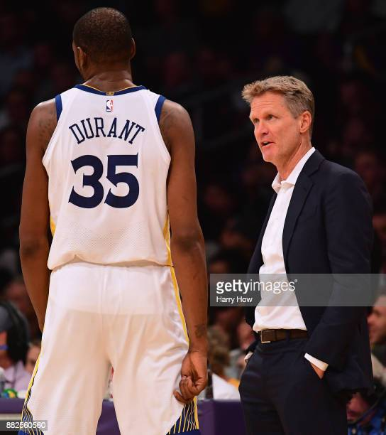 Steve Kerr of the Golden State Warriors looks at Kevin Durant during the fourth quarter against the Los Angeles Lakers at Staples Center on November...