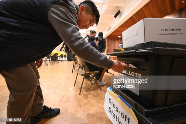 Steve Kim casts his ballot during the presidential primary vote at the public library in Glendale, California on Super Tuesday, March 3, 2020. -...