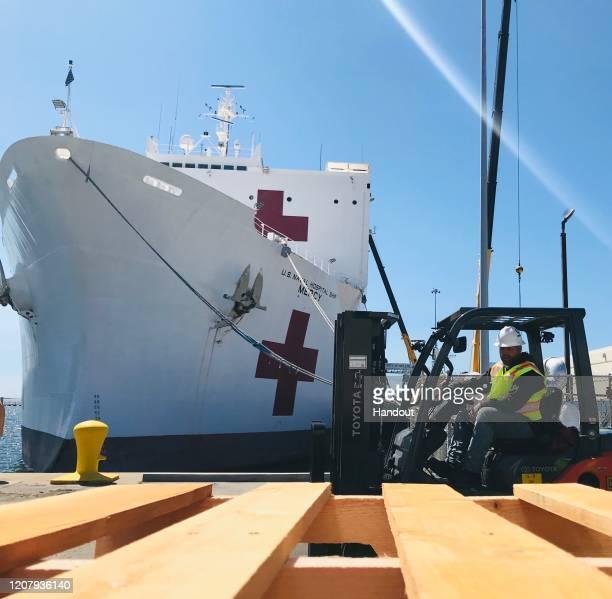 Steve King a Naval Facilities Engineering Command Southwest forklift driver prepares to deliver pallets during a supply load aboard the Military...