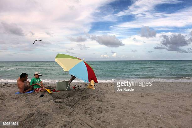Steve Kingston and his son Oliver Kingston have plenty of room on the beach as they vacation from Kent England on August 19 2009 in Hollywood Florida...