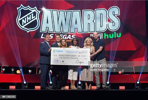 Steve Kreuger Gene Rapisardi guest guest Nicholle Anderson and Craig Anderson of the Ottawa Senators pose with a check from CIGNA to Hockey Fights...
