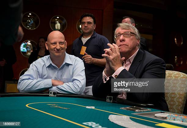 Steve Kuhn head of fixed income trading at Pine River Capital Management left and Jim Chanos founder of Kynikos Associates Ltd sit at a poker table...
